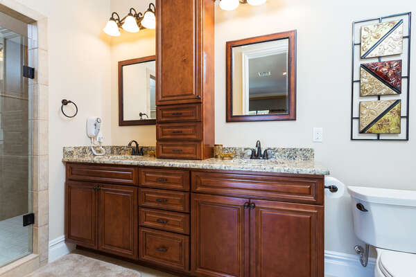 Master suite bathroom 1 has plenty of cabinet space for storage and features double sinks
