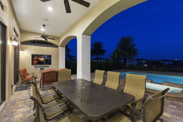The covered lanai is the ideal for a meal while watching your favorite sport