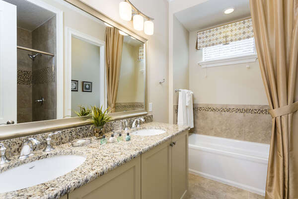 Private ensuite bathroom with dual sinks for him and her