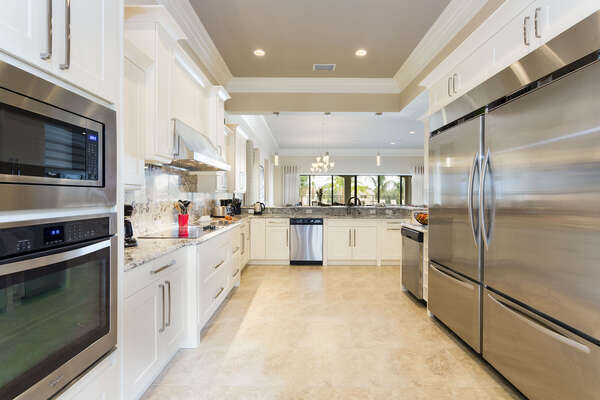 Fully equipped kitchen with extra large fridge and stainless steel appliances