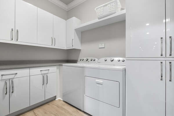 The second floor laundry room makes laundry a breeze during your vacation