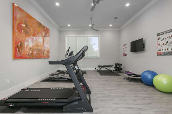 Enjoy a morning workout This home features its own private gym