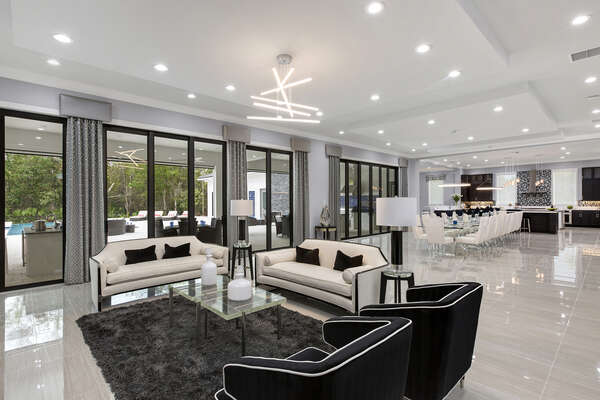 This modern themed living area features a fantastic open concept floorplan perfect for the larger group vacations