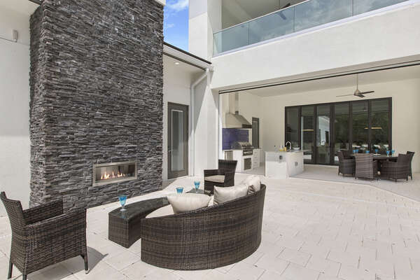 This outdoor seating area is perfect for the evening glass of wine and laughter (Fireplace not allowed for guest use)
