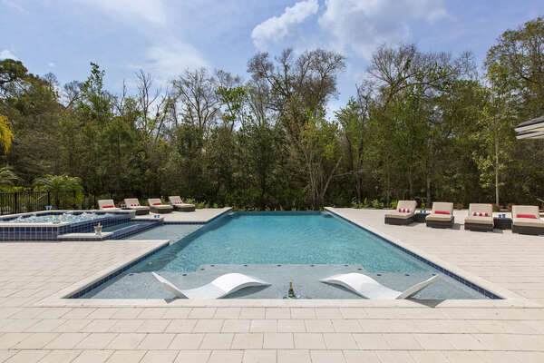 The privacy of this home is one-of-a-kind with simply nature surrounding your outdoor entertainment area and pool deck