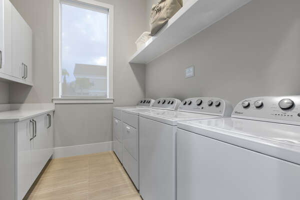 The ground floor laundry room has 2 sets of washers and dryers