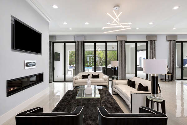In this first living room area sit back and watch a movie (Fireplace not allowed for guest use)