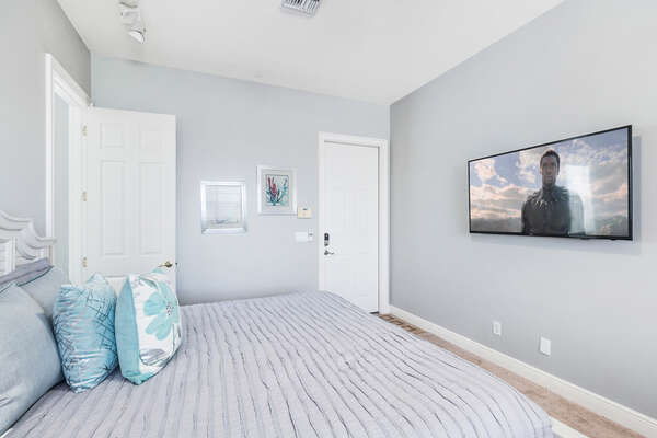 Head upstairs from the annex games room to this large bedroom with a King sized bed