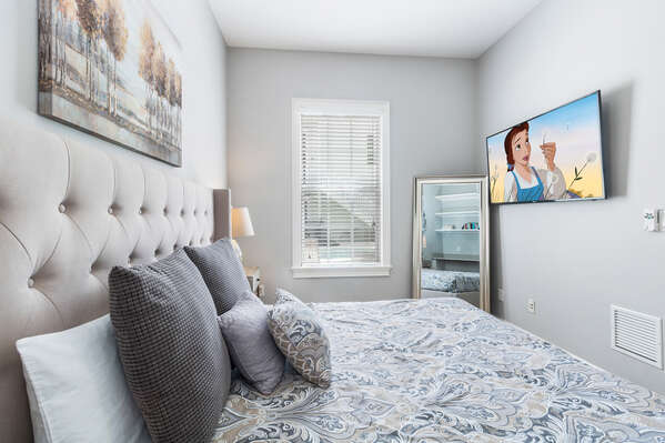 Watch a favorite movie and relax in this comfortable Queen bedroom