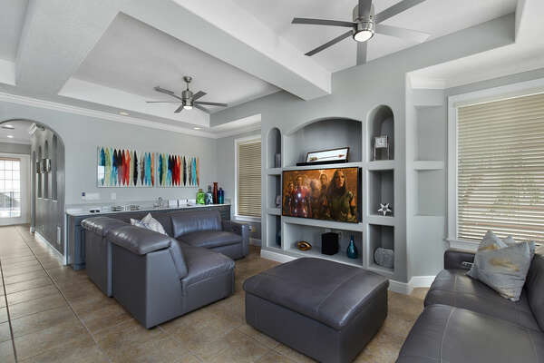 Watch a movie on the flat screen TV and relax on the comfortable couch