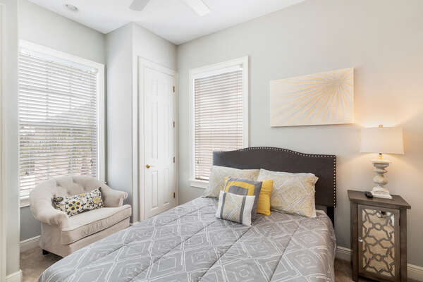 This upstairs bedroom features a comfortable Queen bed