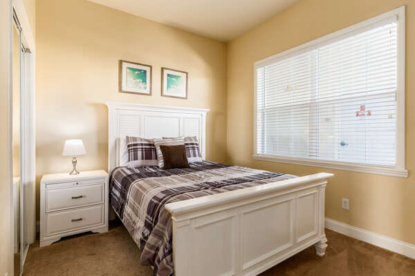 Second luxury bedroom features a queen bed