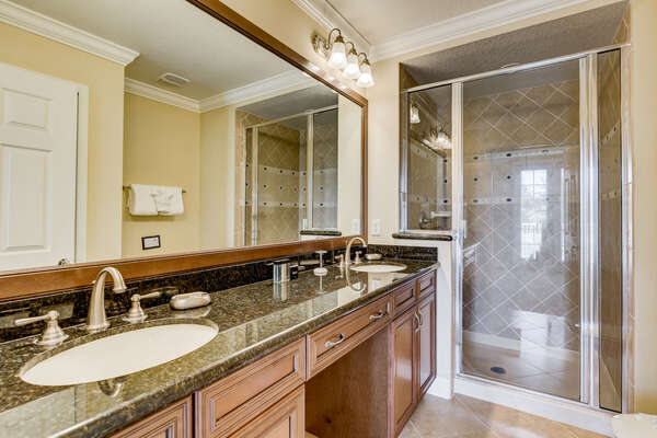 Ensuite bathroom with granite countertops and his and her`s sinks