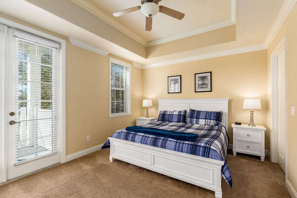 Luxury master bedroom with a king-sized bed, large walk-in closet and ensuite bathroom