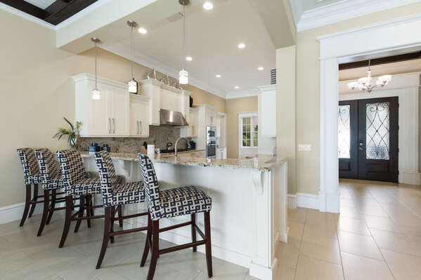 Kitchen includes pull up bar seating