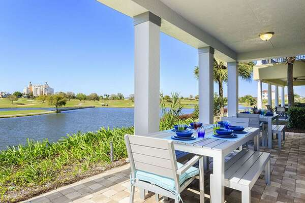 Dine al`fresco in the rear balcony with two table with seating for 8