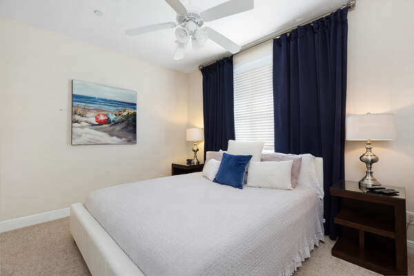 Rest easy in the second Master Suite with king size bed and TV