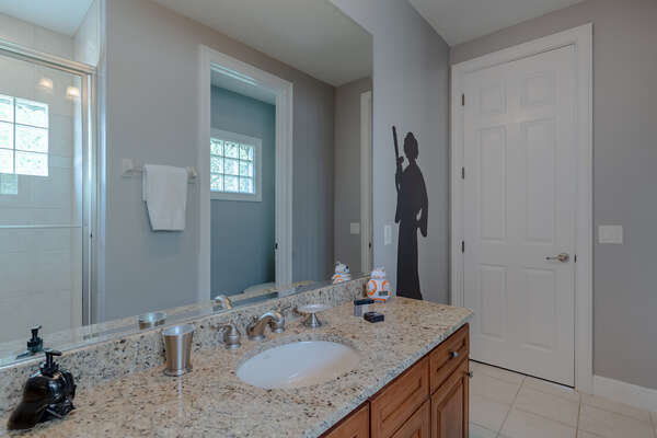A private bathroom with walk-in shower shared with the loft area on third floor