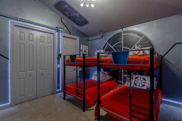 Climb into one of the full over full bunkbeds