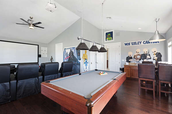 Play pool and watch your favorite sports team on the big screen