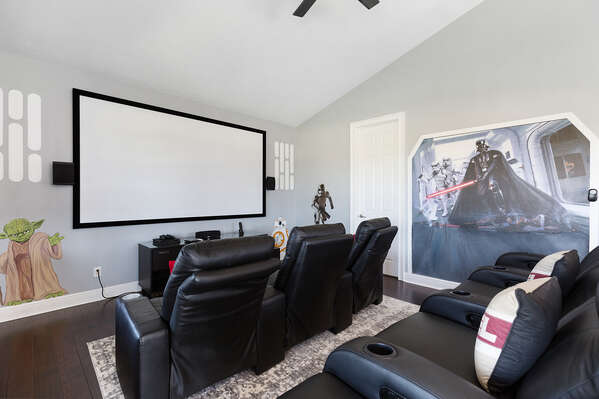 Relax on the 3 leather recliners and sofa seating and watch movies on the 120-inch projector screen with surround sound