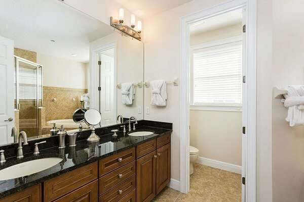 The ensuite bathroom has his and hers vanity