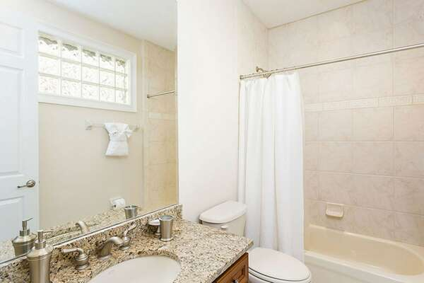 The en-suite bathroom features a shower and tub combination