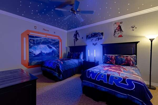 Kids will love this fun galaxy themed bedroom with two full beds and amazing lighting
