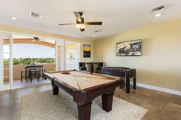 3rd floor games room with 60-Inch HD TV, 8 Ft. slate pool table, wet bar, fridge and foosball table