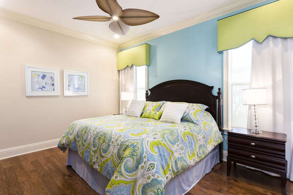 Enjoy this colorful second master bedroom with a King size bed