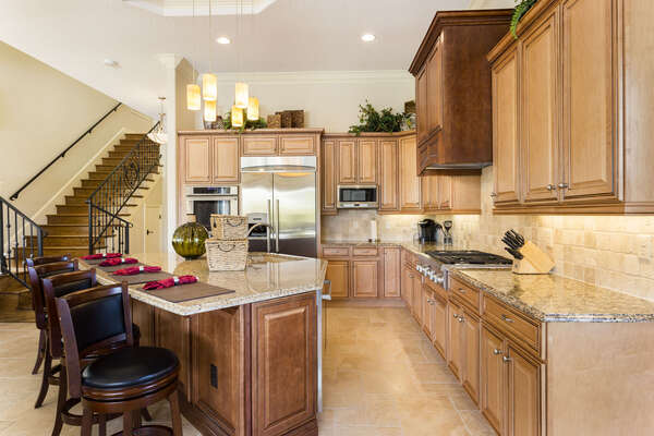 Sit at the breakfast bar and eat your breakfast in this large open kitchen