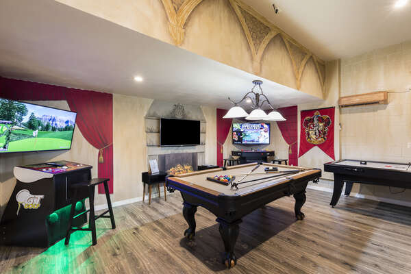The games room with a pool table, an air hockey table, a golden tee golf, and multi-arcade with 10,000 games