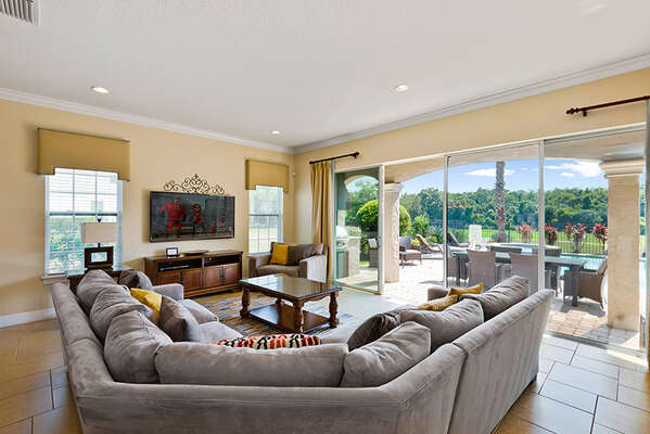 Step inside luxury with the beautiful living room offering views of the back patio and golf course
