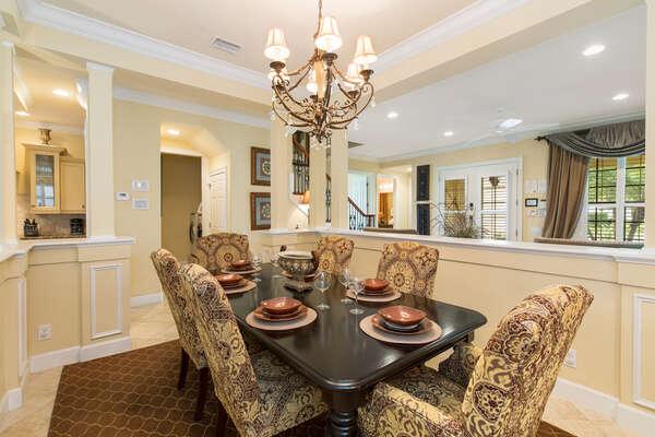 Stylish formal dining area comfortably seats six