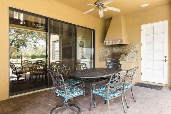 Lanai with summer kitchen and outdoor dining area