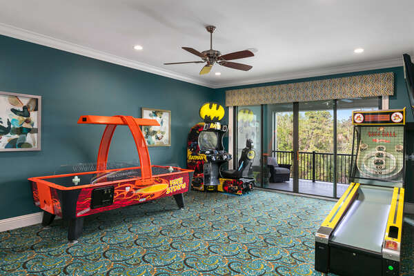 Second floor games room features a Batman Racing Arcade, Skee-Ball, and Air hockey table