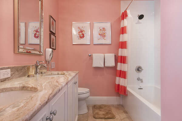 A private bathroom with dual vanity and shower for the princess bedroom