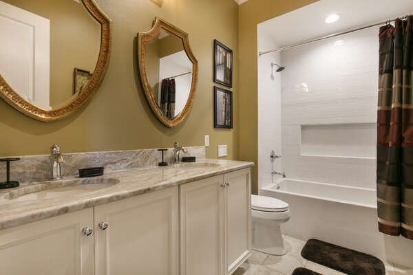 The kids` have a private bathroom with dual vanity and shower