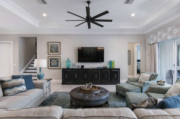 The living area features a 70-inch SMART TV