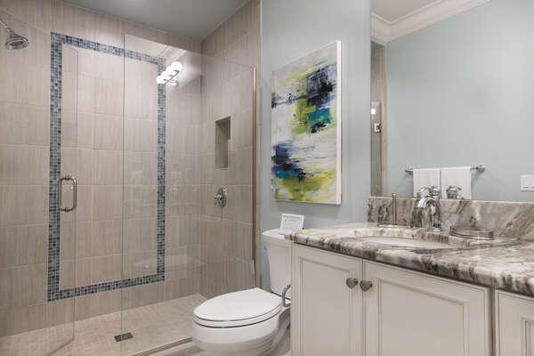 En-suite master bathroom with glass walk-in shower and dual vanity