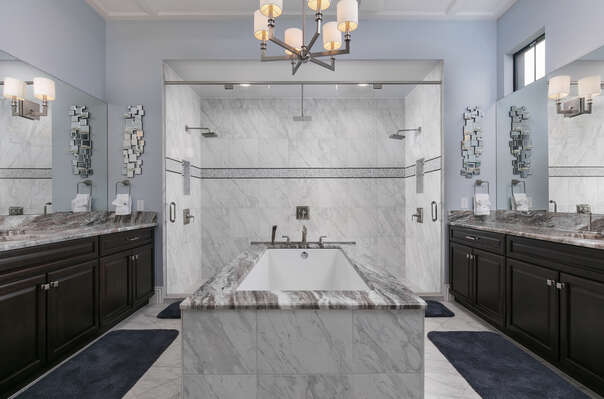 Large ensuite bathroom with amazing jacuzzi tub and glass door walk-in shower