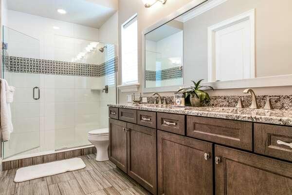 En-suite bathroom with dual vanity and a walk-in shower