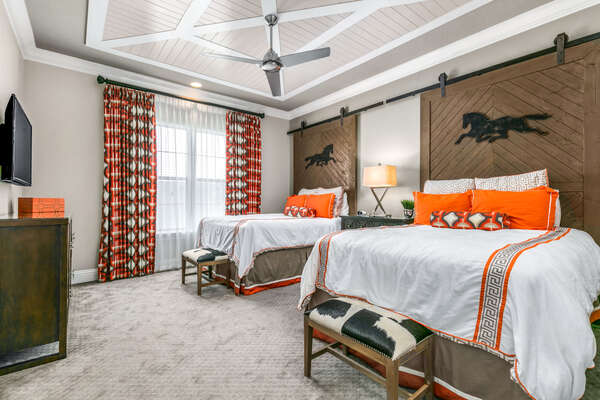 The Equestrian bedroom features two queen beds with an en-suite bathroom