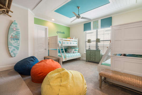 The custom kids bedroom has two sets of full/twin bunk beds