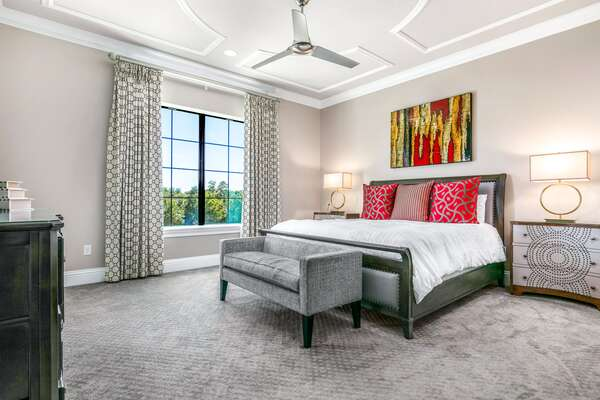A master suite located on the second floor with a king size bed