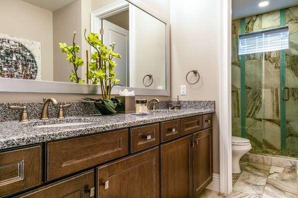 En-suite bathroom with dual vanity and walk-in shower