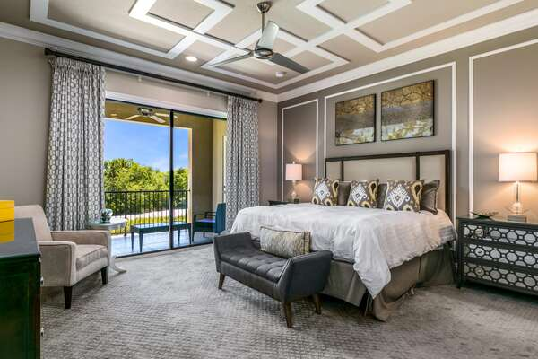 A master suite located on the second floor with king size bed, en-suite bathroom, and access to the balcony