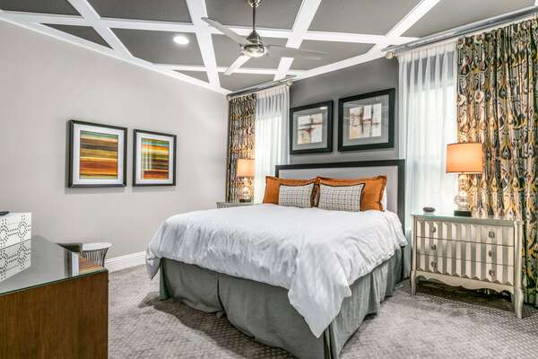 The master suite with a king size bed and en-suite bathroom