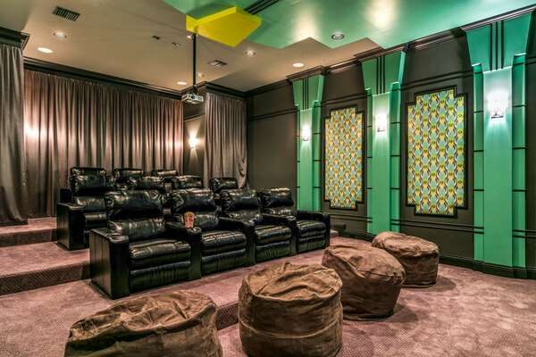 Watch your favorite movie in the Art Deco theater room located on the second floor