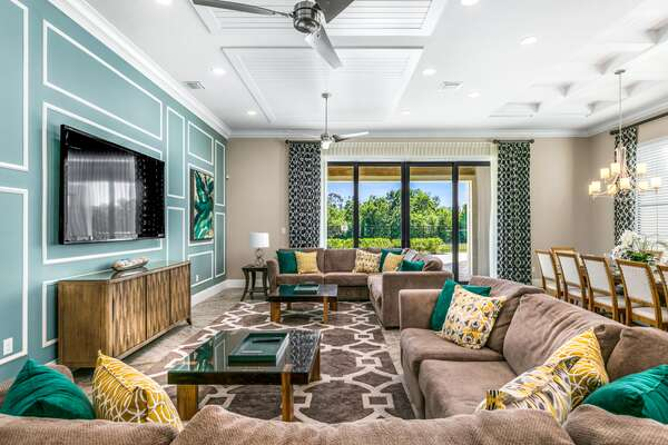 Spacious and comfortable living area with a beautiful view to the pool area